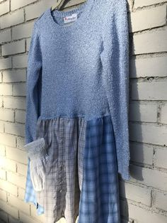 This is the Robyn Tunic: Such a beautiful icy blue sweater now upcycled to a dreamy tunic that you will enjoy wearing during the cooler months. The size is Small to medium. This would be lovely paired with skinny jeans or capris in the warmer months. I started with a very soft and