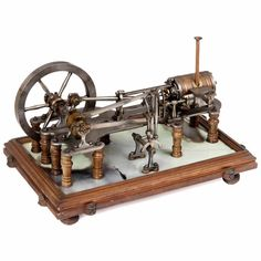 Early Model Steam Engine, c. 1890Large precision model, cast iron, steel and brass, 6-spoked flyw Cast Iron, It Cast, The Saleroom, Iron Steel, Steam Engine, Toy Sale, Science And Technology, Trains, Steampunk