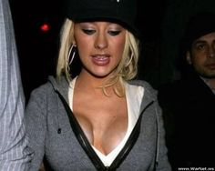 All that money and her boobs look like that... What a shame.