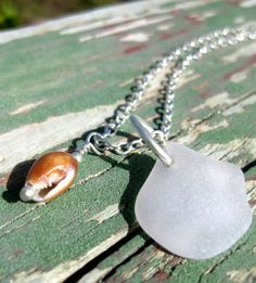 Hawaiian clear beach glass with brown puka shell charms on silver plated materials. Handmade with aloha :) only $21.00