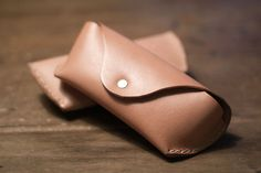 Leather sunglass cases.