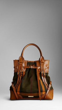 Burberry bag/tote. Love the color palette and the handle.