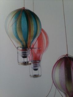 Hot Air Balloon Ornaments: Use Modge Podge to attach strips of colored tissue paper to old light bulbs, tie a string around light bulb, and use a champagne cork cage for the basket. Champagne Cork Crafts, Champagne Corks, Diy Hot Air Balloons, Wine Cork Ornaments, Cork Art, Old Lights, Bottle Cap Crafts, Craft Corner, Upcycled Crafts