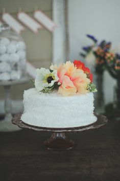 simple white wedding cake with floral decoration