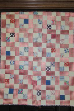 red, blue and white quilt