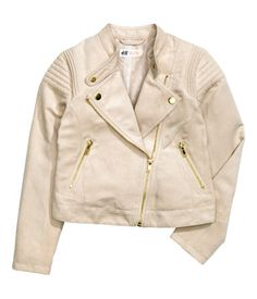 Biker jacket in soft imitation suede with a small stand-up collar with press-studs, a diagonal zip at the front, zipped pockets and quilted sections on the sleeves. Lined.