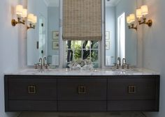 The main-floor master bath, which combines contemporary and traditional design elements, is luxurious and functional, with a double vanity graced by a marble countertop and Purist faucets.
