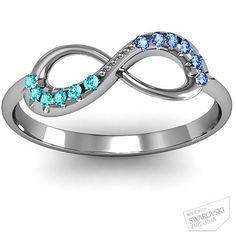 Infinity ring with his and hers birthstones. Beyond adorable.