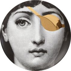Fornasetti Theme and Variations Gold Eyepatch Black and White Face Plate Black And White Face, Piero Fornasetti, Italian Painters, Gold Eyes, Instagram Tips, Whimsical Art, Luxury Gifts, Woman Face, Printable Art