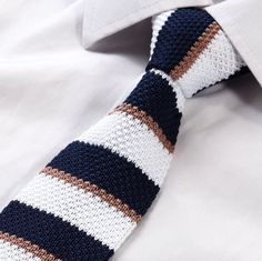 "Product number: K-SKNY-1227 Length: 59"" Width: 2.25"" Material: 100% Microfiber Care: Dry Clean / Spot Clean Label: GENTLEMAN JOE This navy, taupe & white striped, knit tie will give you that fresh, cl"