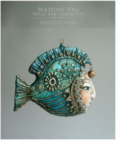 We're wrapping up our week of fish with a love of art dolls. And ornaments. So it's no wonder some odd but beautiful item like this fish ornament by doll and toy maker Nadine Pau would catch our eye. I'm enjoying the hint of Steampunk in this piece, with the metallic rivet-like accents, and the serene face. Check out her gallery and our Inspirational Challenge at The Polymer Arts magazine blog, http://www.thepolymerarts.com/blog/12235