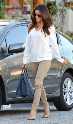 Eva Longoria manages to make a simple outfit of taupe pants & a white shirt look polished