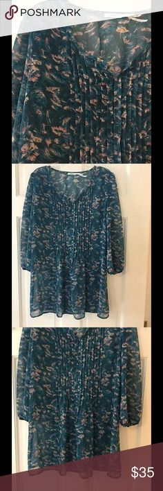 "Kimchi Blue semi sheer floral blouse Pretty floral top with front clasps, button cuffs and a small amount of elastic gathering in the back. 100% polyester. Underarm across 18"". Length 28"". Excellent condition. EUC. Urban Outfitters Tops Blouses"
