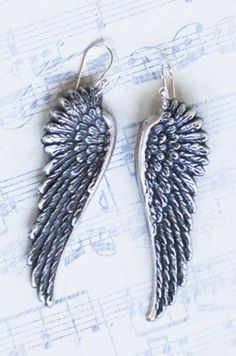 Silver ANGEL Wing EARRINGS...i used to have a pair like these and they just vanished :( loved em.