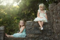 girls sitting on rocks by Sally Kate Photography