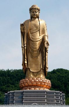 The largest statue in the world towers at 420 feet high atop another 66 feet of pedestal.