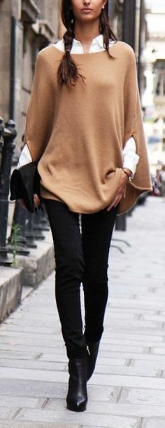 Camel knit poncho over a white blouse with black skinny pants. Effortless street style.