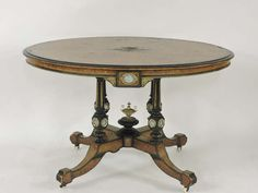 A Victorian burr walnut and ebonised oval loo table. Sold for £150