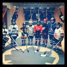 Players stand in the Marlies locker room prior to the start of the clinic