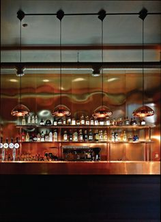 Tom Dixon copper pendants and a copper-clad bar makes the space warm and cosy - Image: Union Restaurant Basel