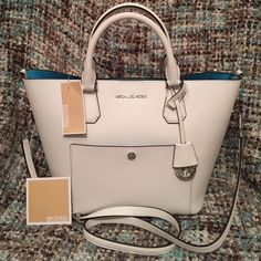"""Michael Kors Greenwich Satchel Large MIchael Kors Greenwich Grab bag satchel in white/Aquamarine saffiano leather = gorgeous bag!! Has shoulder straps with a (5"""" drop) & a crossbody strap (with an 18.5-21"""" drop) plus 2 different hook options. 11H X 11W X 7D. NWT + card (no dust bag) NEW & perfect with cards/tag! *No dust bag* Michael Kors Bags Satchels"""