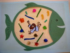 Jonah and the Whale craft. Draw or print fish. Cut out belly. Use sticky contact paper. Stick on one side, sticky side up. Let kids feed the whale (w/ Jonah and...). Cover with another piece of contact paper. Hang in window. No templates
