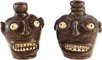 South Carolina Face Jugs, salt fired stoneware,  circa 1862.  Enslaved Africans created face jugs during a flourishing pottery trade in the early 1800's.