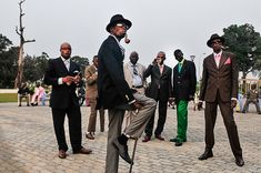 """Sapeurs posing in front of Memorial Savorgnande Brazz."" Brazzaville, Republic of Congo. 2008."