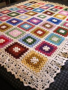 Pretty granny square blanket with lacy edging from Doris Chan's 'All Shawl' (link here - http://www.ravelry.com/patterns/library/all-shawl# ) on this granny square throw . . . . ღTrish W ~ http://www.pinterest.com/trishw/ . . . . #crochet