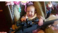 Baby Holding Gun In Facebook Photo