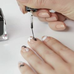 A step-by-step tutorial for getting the perfect black and white manicure.