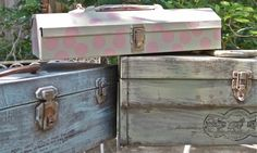 OK.  These aren't suitcases....but tool boxes.  Very cute...I think I will need to keep my eyes open for old tool boxes now that garage sale season is finally here!