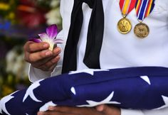 121207-N-RI884-184 PEARL HARBOR (Dec. 07, 2012) Culinary Specialist Seaman Jesiica Wilson participates in a floral tribute during the interment of Seaman 1st Class Wallace F. Quillin at the USS Arizona Memorial on Joint Base Pearl Harbor-Hickam. The guests included Pearl Harbor survivors and other veterans at the National Park Service and U.S. Navy-hosted joint memorial ceremony. (U.S. Navy photo by Mass Communication Specialist 2nd Class Daniel Barker/Released)
