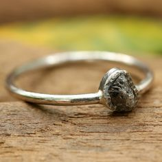 Sterling silver ring with teardrop dark grey rough diamond ring in bezel setting