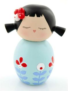 """Kokeshi"" or ""doll"" is a great souvenir/gift.  Sturdy and easy to pack.  This one is more modern, the classic ones are cute.  I have like, 10 ; )"