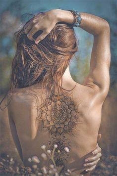 Henna tattoo on the girls back