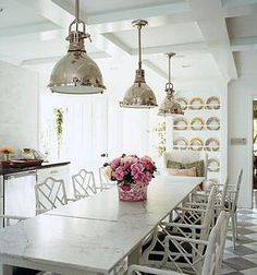 I would love to sit here for a meal, love light fixtures too