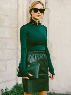 Fall Outfit Idea: A Zip Neck Black Turtleneck and a Leather Skirt. Moto Chic. // More Fall Bag Inspiration From The Best Street Style From Paris Fashion Week: (http://www.racked.com/2015/10/2/9439243/paris-fashion-week-street-style#4844710)