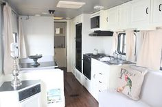 RV Redo: Delightful Upgrade. I don't understand why rv makers have such a fetish for faux wood interiors. Brighten it up! Travel Trailer Remodel, Rv Trailer, Trailer Decor, Rv Redo, Vintage Travel Trailers, Vintage Campers, Vintage Rv, Vintage Airstream, Black Countertops