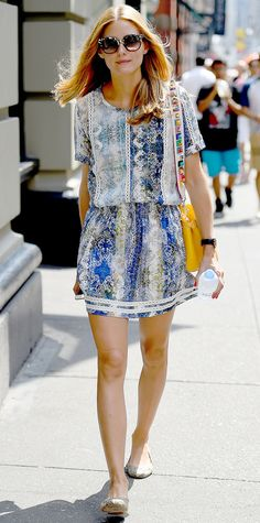Olivia Palermo seen wearing a blue printed dress while walking in New York City