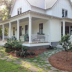 porch on both sides of farm house, rock walkways...love