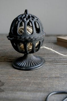 antique cast iron string holder  (My husband actually found one like this and now it sits on a shelf in the kitchen).