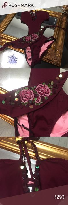 NWOT Becca Virtue monokini This plum colored monokini is soooo cute on. Embroidered flower with small seen on fabric and plastic circles. I bought it for my honeymoon 8 years ago and never was able to fit it. Pink lining. Size Large but fits snug if your curvy BECCA Swim One Pieces