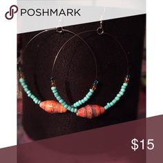Turquoise Hoop Earrings Handcrafted hoop earrings with turquoise beads and hand rolled signature beads from Uganda. Ready to pair with the perfect outfit from our online boutique Jewelry Earrings