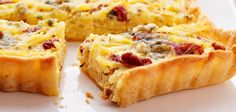 A healthy Bacon and Potato Quiche made with refrigerated hash browns, Hormel bacon, crumbled blue cheese, garlic and herb seasoning, Egg Beaters, heavy cream and milk.