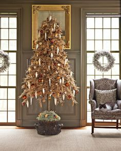 This modern tree, which has been placed in Martha's Bedford, New York living room in years past, has lots of full boughs, allowing for many ornaments. Standing in a faux-bois basin filled with deer moss and mushroom ornaments, it's trimmed with owls, polar bears, acorns, pinecones, silver and bronze balls, and more mushrooms.