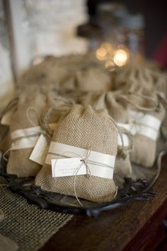 Burlap bags for wedding favors. Filled with Forget Me Not Seeds. With poem attached. Please plant these forget me nots To make sure this evening is not forgot May they grow forever and flowers you will see Given with love by....