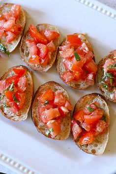 Tomato Basil Bruschetta    Ingredients:  3 tomatoes, seeded and diced  2 cloves garlic, finely minced  3 tbsp. basil, minced  ¼ tsp. kosher salt  Pepper, to taste  1½ tbsp. extra-virgin olive oil  2 tbsp. finely grated Parmesan  Toasted baguette slices, for serving    Directions:  Combine all ingredients in a medium bowl; mix well to blend.  Cover and refrigerate for at least 30 minutes to allow the flavors to meld.  Spoon the tomato mixture on top of the baguette slices and serve.