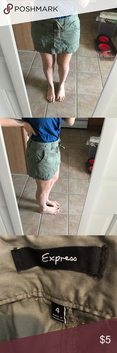 EXPRESS ARMY GREEN SKIRT Spring cleaning closet clear out! In excellent pre loved condition with no noticeable signs of wear. Price set and looking to pass on asap. Items in the clear out are priced exceptionally low already, please refrain from offering on items set $10 and below. Express Skirts Mini