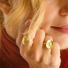 gold signet ring with embossed Octopus design. Octopus Ring, Gold Jewelry, Fine Jewelry, Octopus Design, Diamond Earrings, Pearl Earrings, Ring Displays, Signet Ring, Exclusive Collection